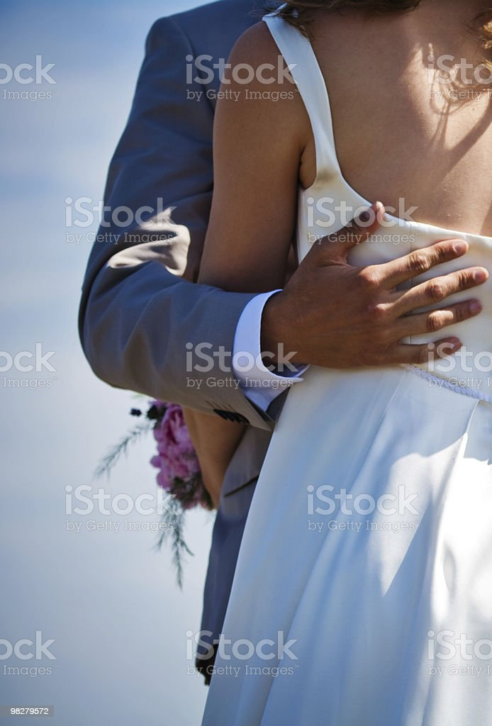 bridal couple embracing for first time as married royalty-free stock photo
