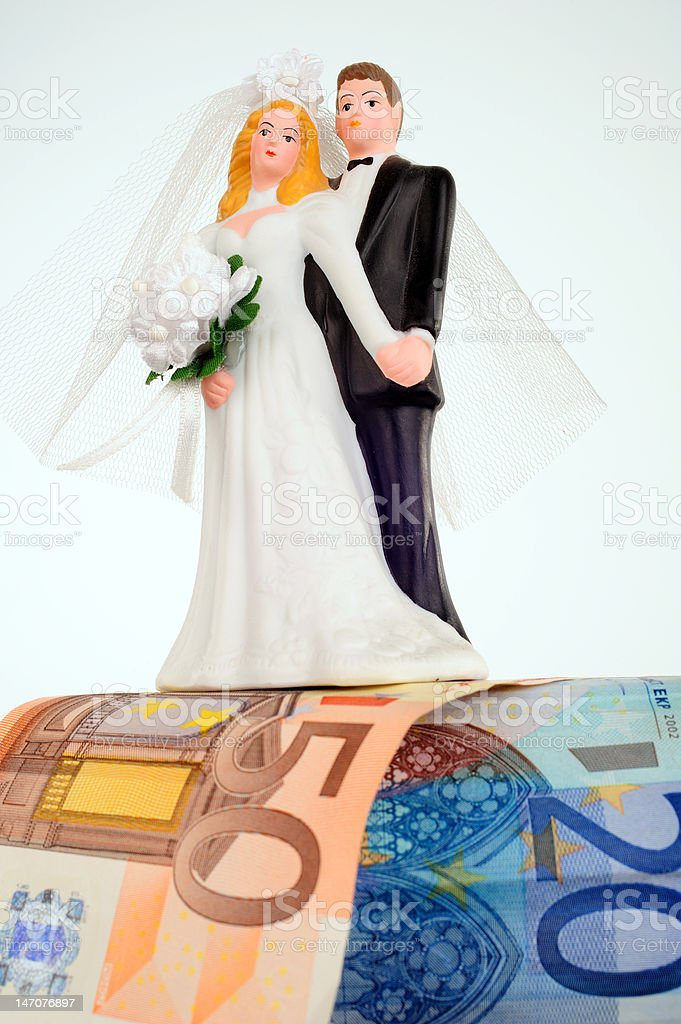 bridal couple with money royalty-free stock photo