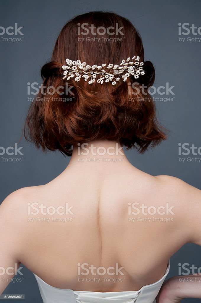 Bridal fashion. View from the back. Strapless dress. stock photo