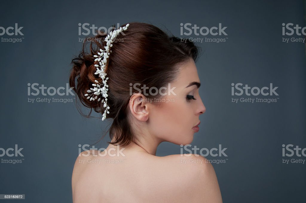 Bridal hairstyle. Brunette with curly hair and beaded headpiece. stock photo