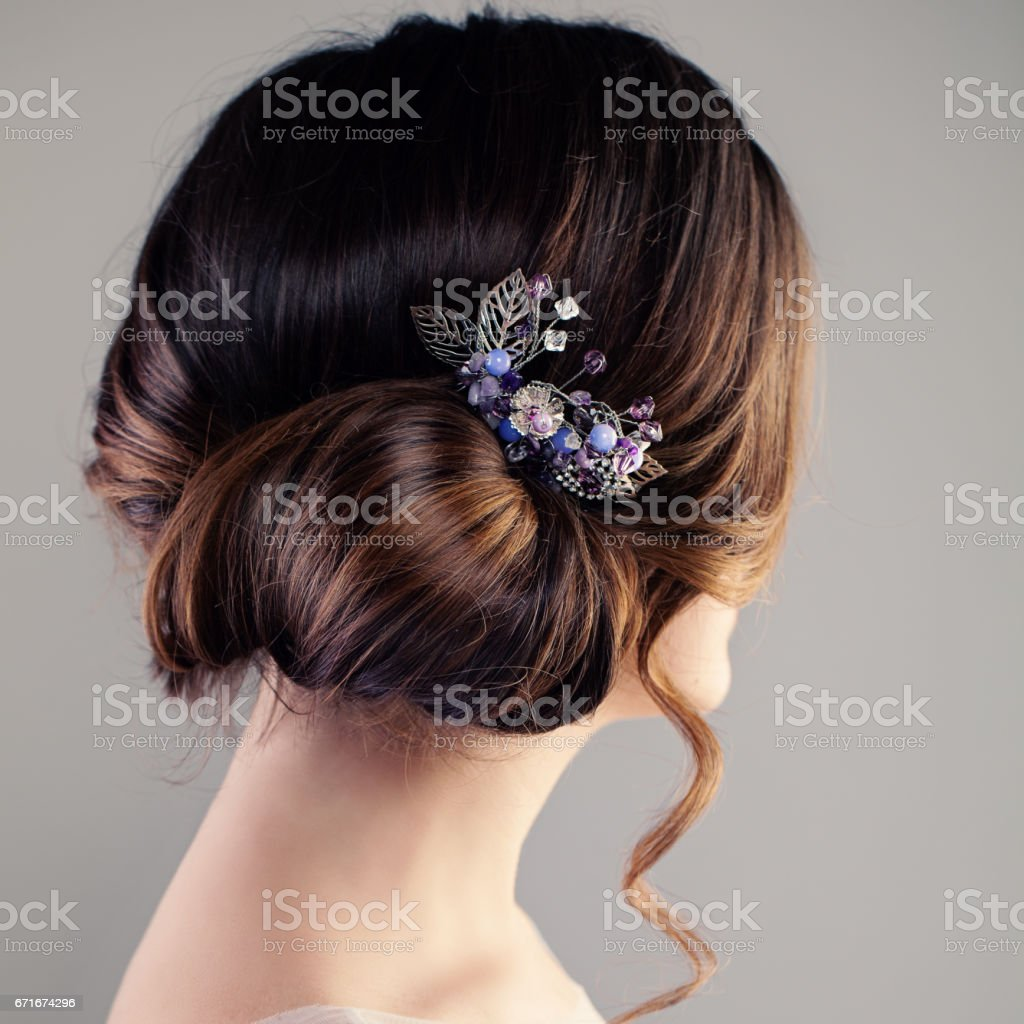 Bridal or Prom Hairstyle. Beautiful Woman with Brown Hair and Hairdeco, Back View stock photo