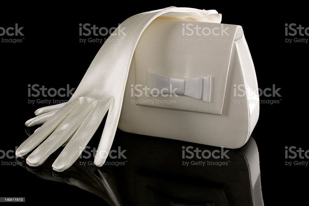 bridal satin gloves and a purse stock photo