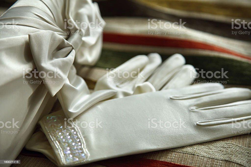 Bridal satin gloves stock photo