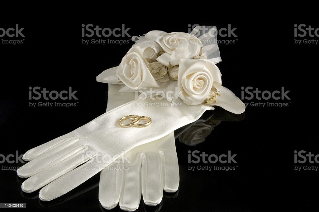 bridal satin gloves with wedding rings stock photo