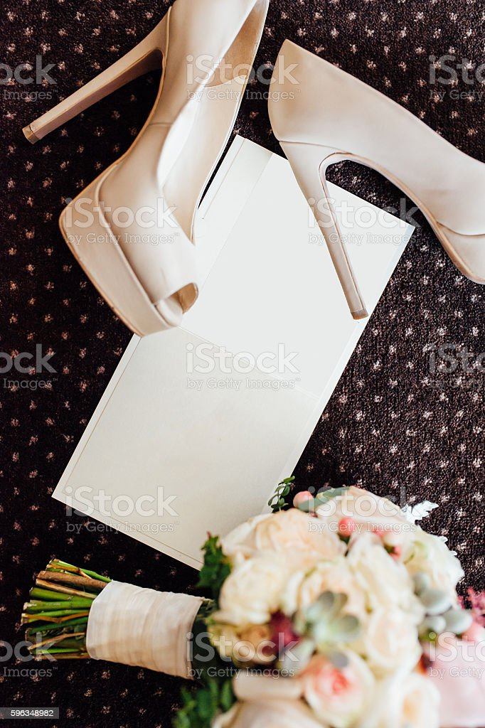 bridal shoes and bouquet with invitation royalty-free stock photo