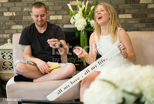 Engaged couple open gifts at a bridal shower, Midwest, Minnesota, USA