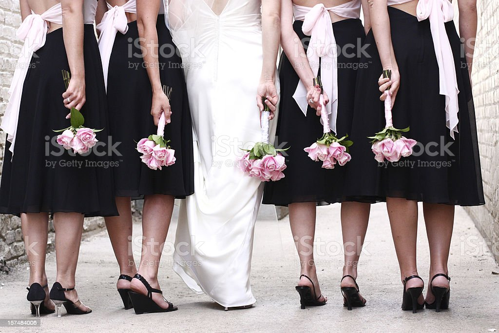 Bridal Wedding party with pink rose bouquets stock photo