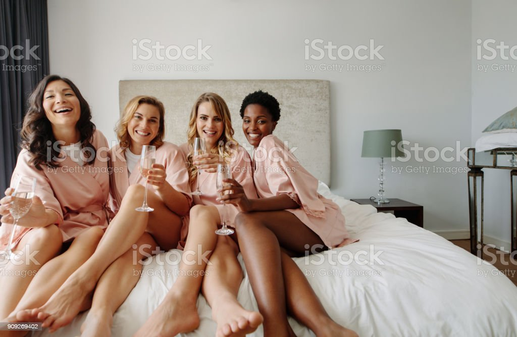 Bride and bridesmaids celebrating bachelorette party stock photo