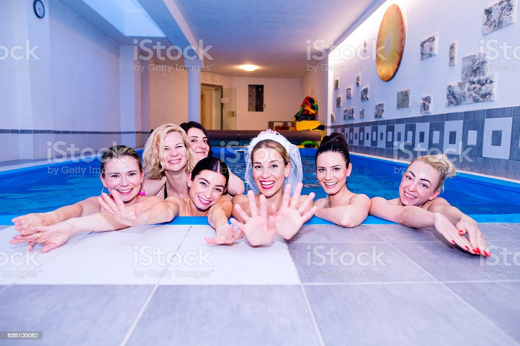 Bride and bridesmaids celebrating hen party in wellness center stock photo