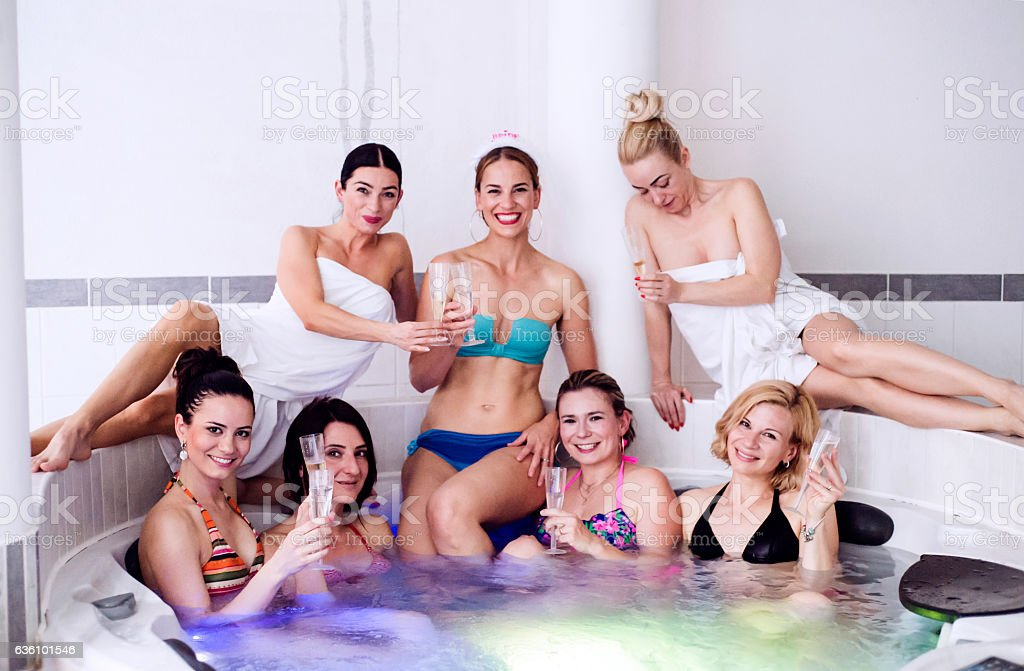 Bride and bridesmaids celebrating hen party in wellness center - Photo