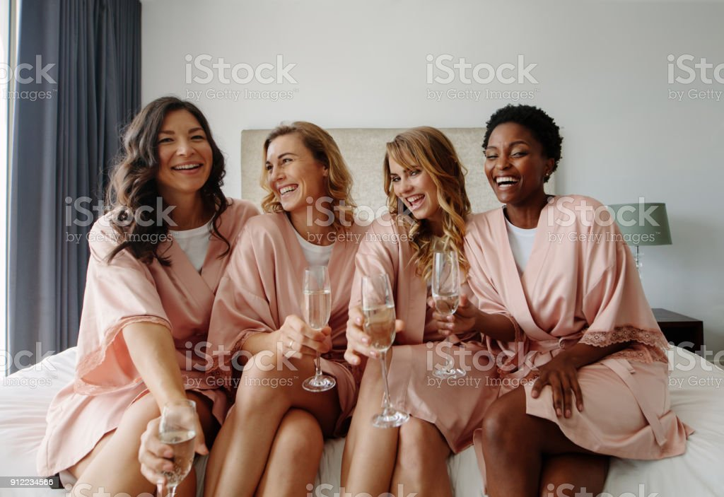 Bride and bridesmaids celebrating hen party stock photo