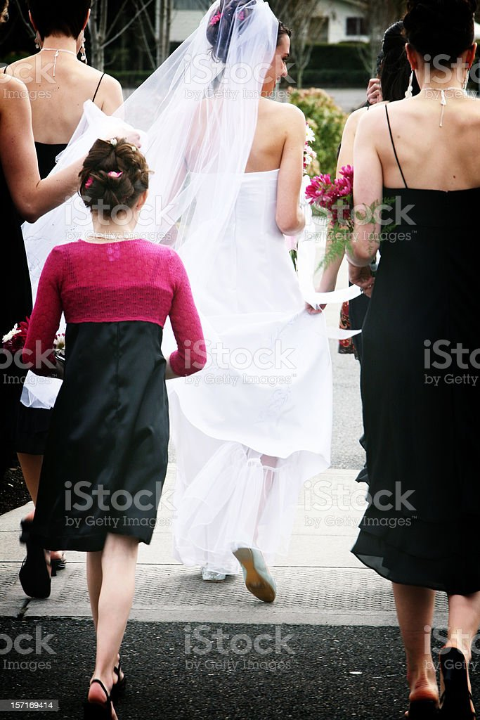 Bride and Bridesmaids Heading Out. royalty-free stock photo
