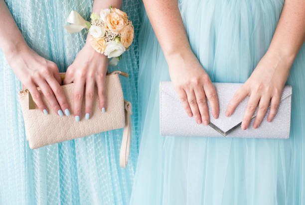 Bride and bridesmaids showing beautiful bags.Wedding in turquoise color. stock photo