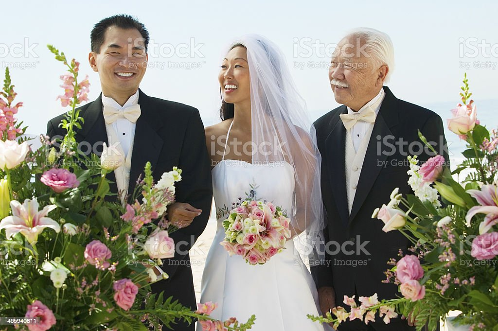 Bride And Father Looking At Groom stock photo