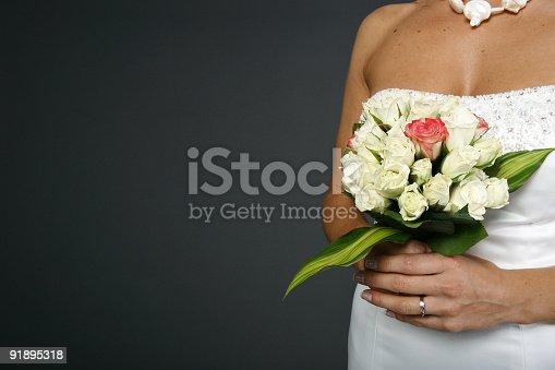 Bride holding a fresh flower arrengement