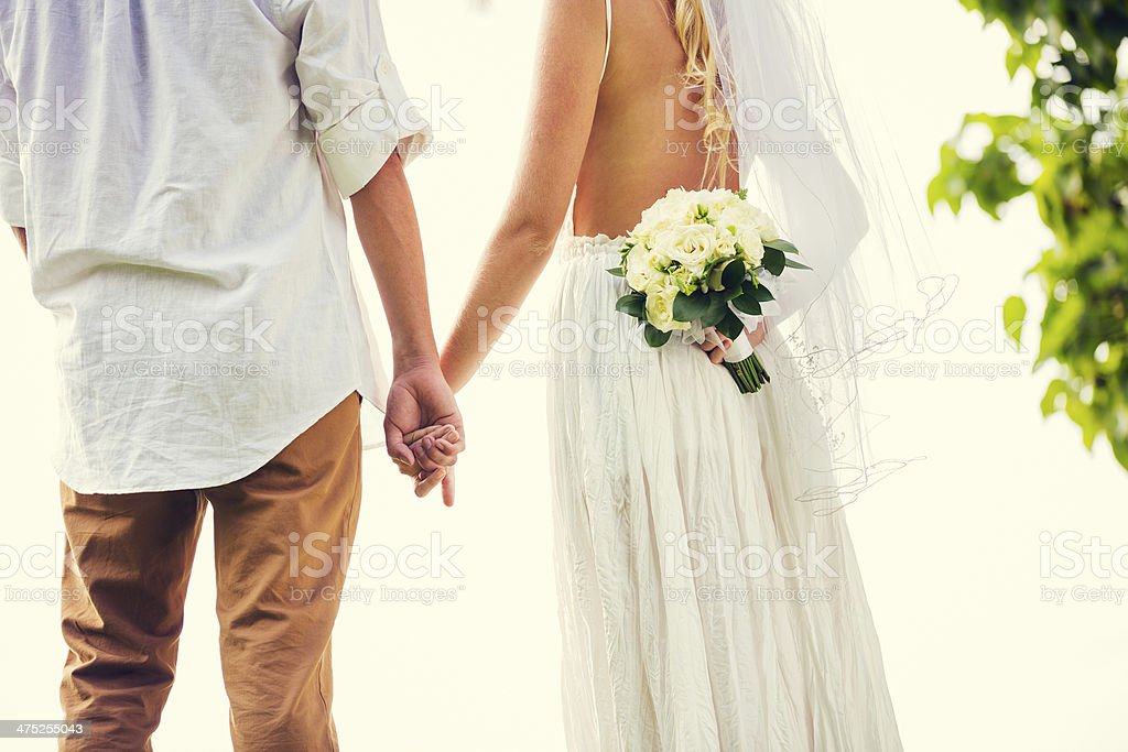 bride and groom at sunset on tropical beach royalty-free stock photo