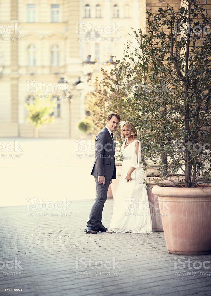 Bride and groom attown square. royalty-free stock photo