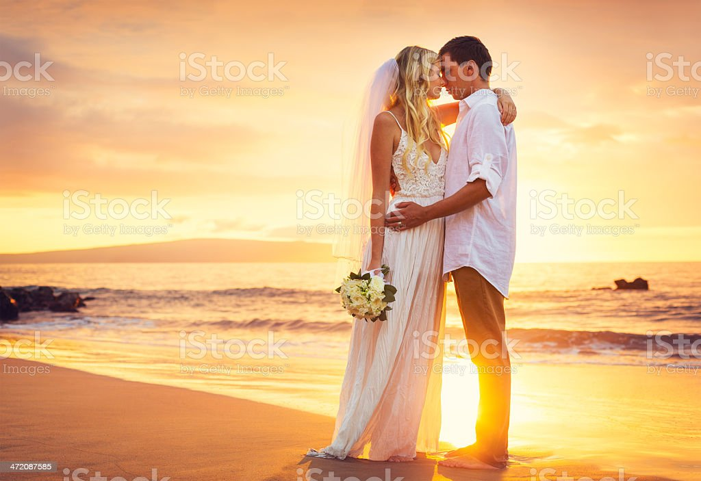 Bride and Groom, Beautiful Tropical Beach at Sunset stock photo