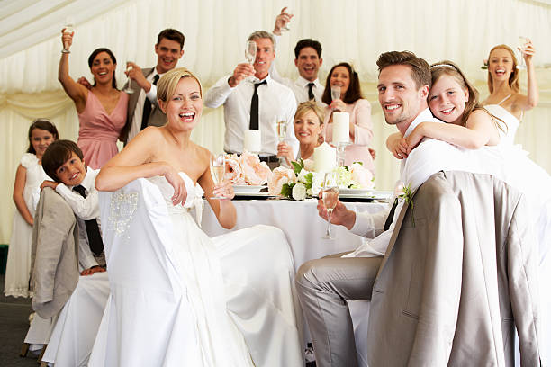 bride and groom celebrating with guests at reception - guest stock pictures, royalty-free photos & images