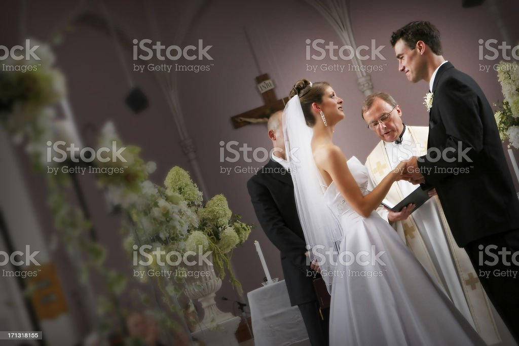 Bride and Groom Couple At the Alter During Wedding Ceremony stock photo