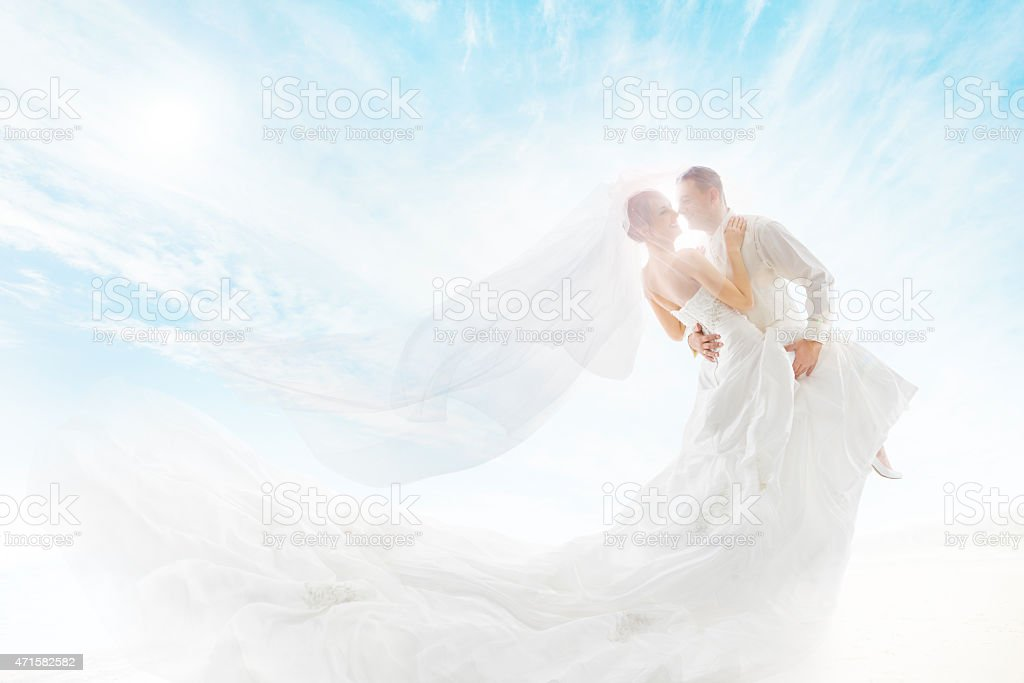 Bride and Groom Couple Dancing, Wedding Dress and Long Veil stock photo