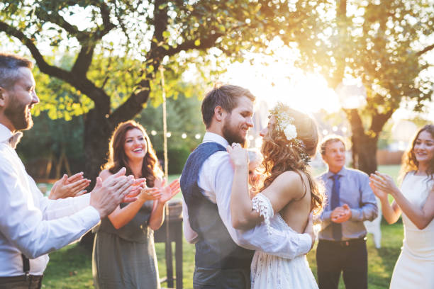 bride and groom dancing at wedding reception outside in the backyard. - wedding stock photos and pictures