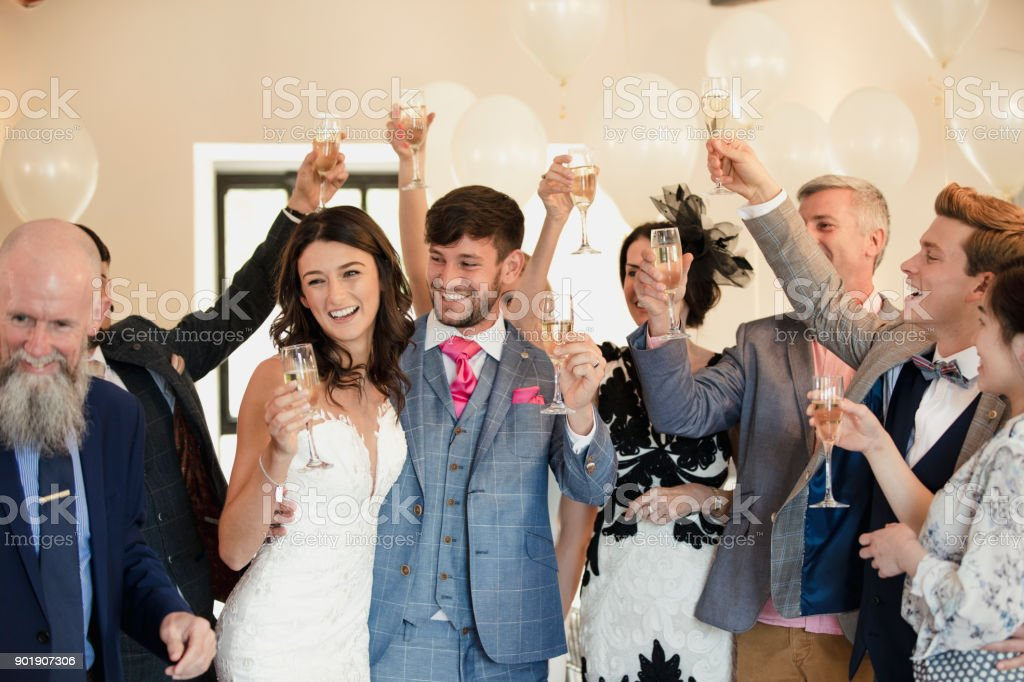 Bride And Groom Dancing With Guests stock photo