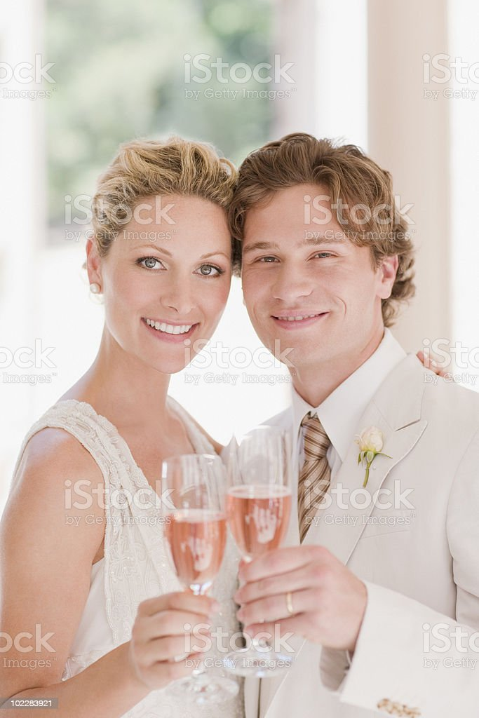 Bride and groom drinking champagne stock photo