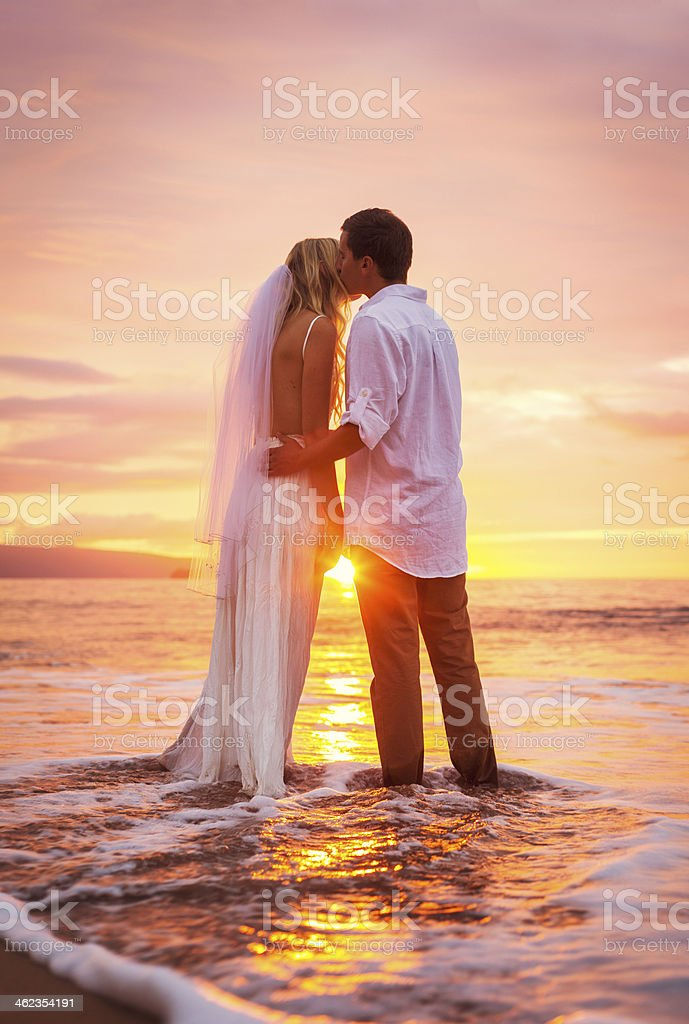 Bride and Groom, Enjoying Amazing Sunset stock photo