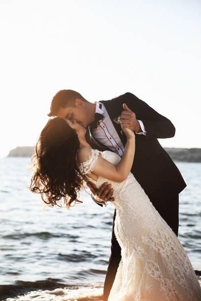 Bride and Groom, Enjoying Amazing Sunset stock photo