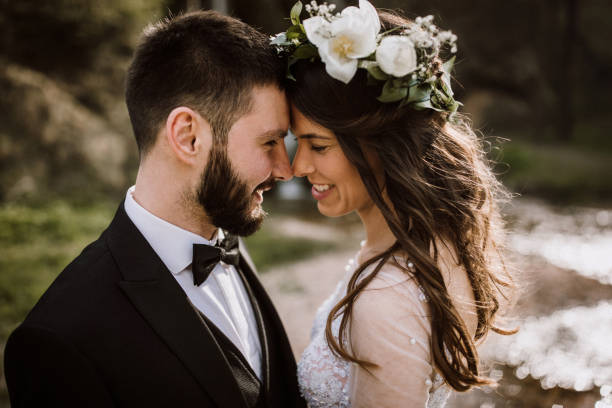 Bride and Groom enjoying in their love stock photo