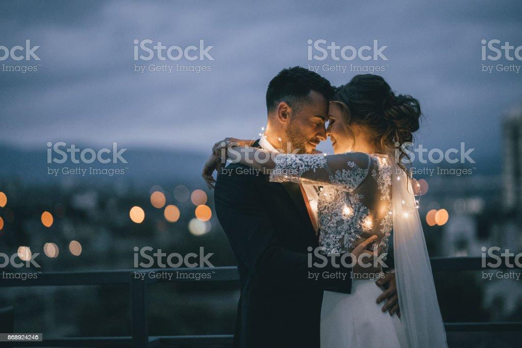 Bride and Groom enjoying in their love - Foto stock royalty-free di Abbracciare una persona