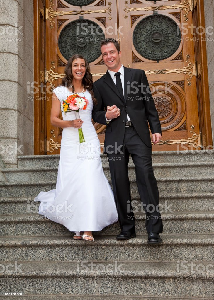 Bride and Groom Exiting Church royalty-free stock photo