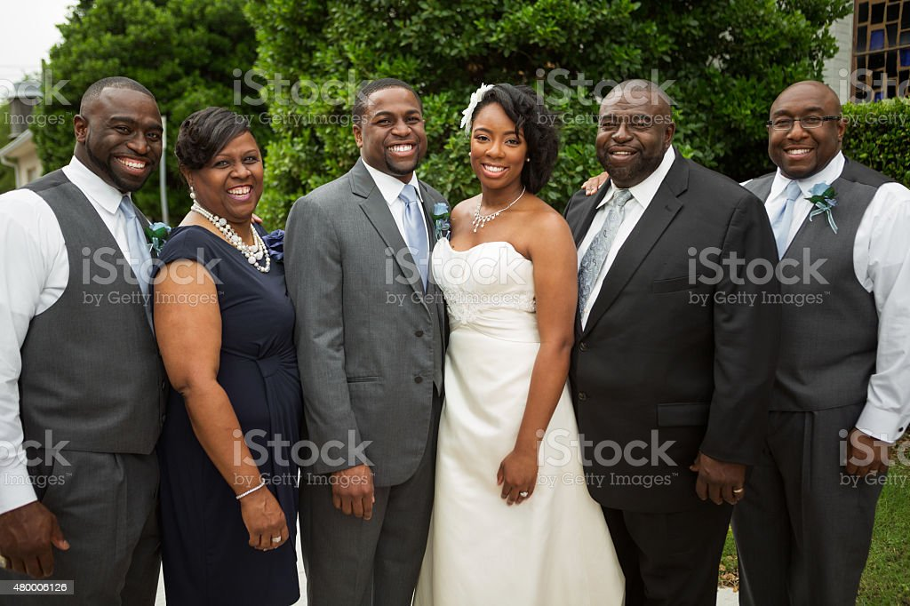 Bride and groom family portrait. stock photo