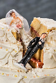 istock Bride and groom figurines collapsed at ruined wedding cake 479936504