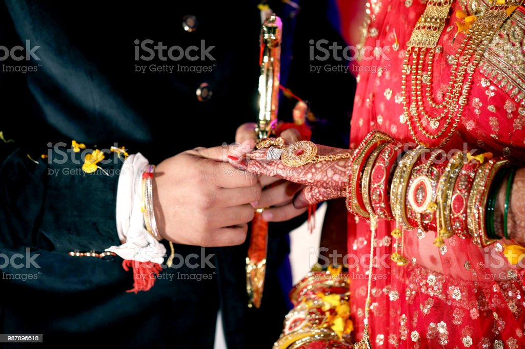 Bride And Groom Hands Holding Bridal Showing Wedding Jewelry Ring