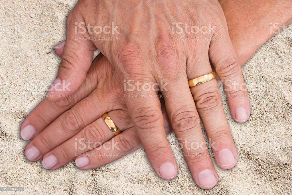 Bride And Groom Hands With Rings stock photo