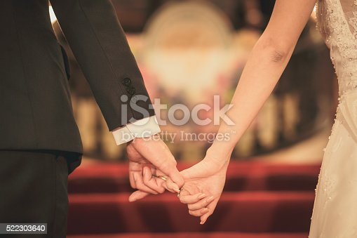 Bride and groom holding hand waiting for wedding ceremony
