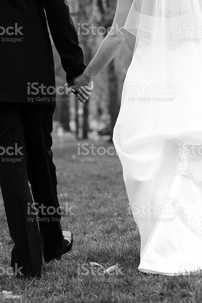 Bride and Groom holding hands in Black & White royalty-free stock photo
