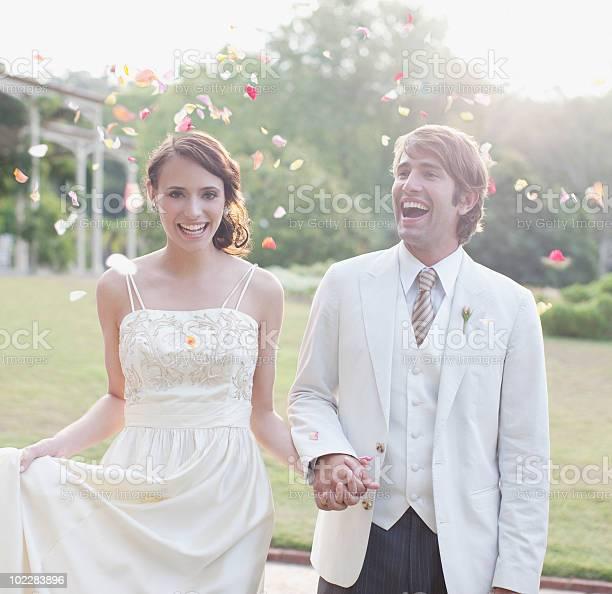 Bride and groom holding hands picture id102283896?b=1&k=6&m=102283896&s=612x612&h=4sw 1frdwibvedb gv8s9livj6bm2z ptdhb9lhwxce=