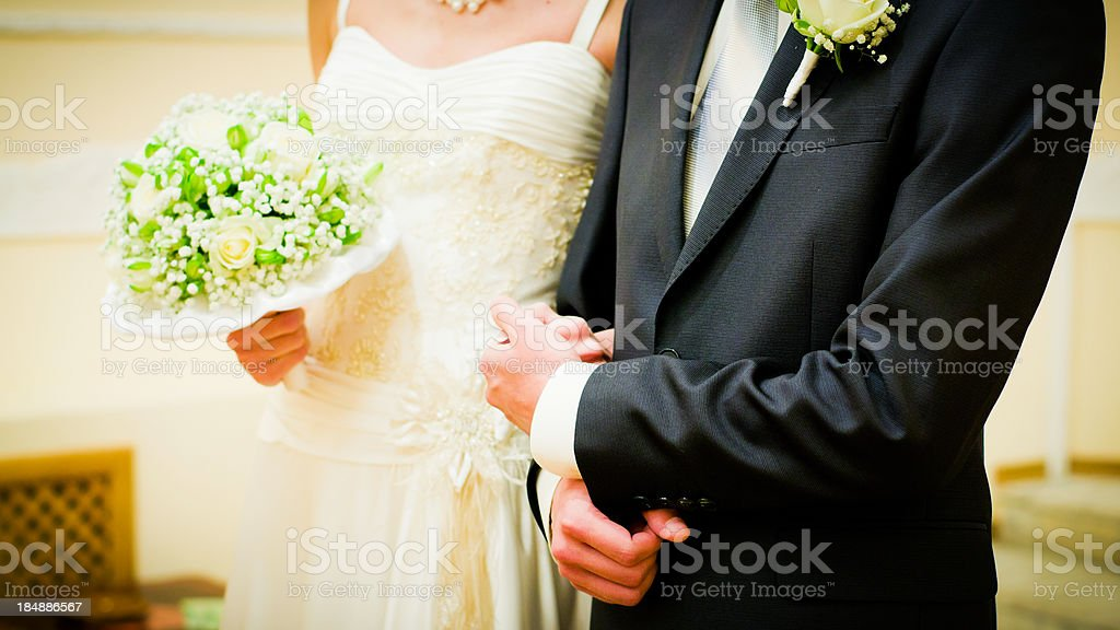 Bride and groom holding hands royalty-free stock photo