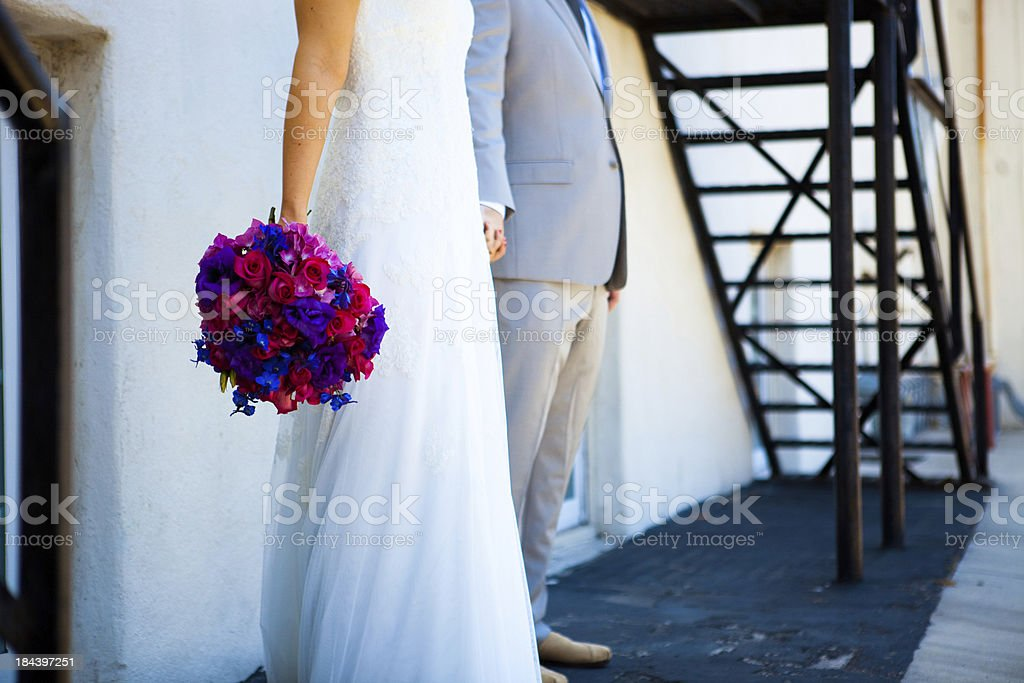 Bride and Groom holding hands - side view royalty-free stock photo