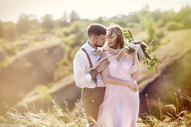 bride and groom hugging at the wedding - eheringe öko stock-fotos und bilder