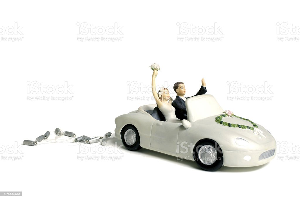 Bride and groom in a car cake topper royalty-free stock photo