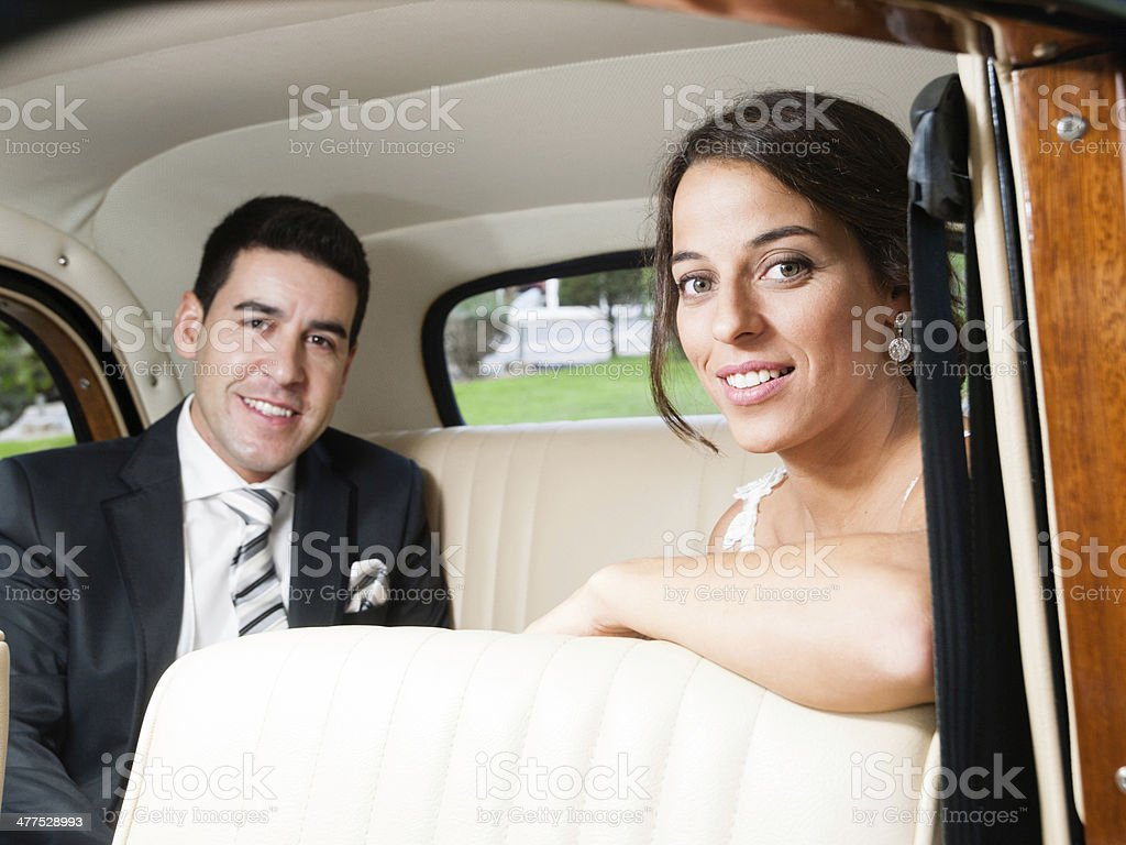 Bride and groom in a classic car stock photo