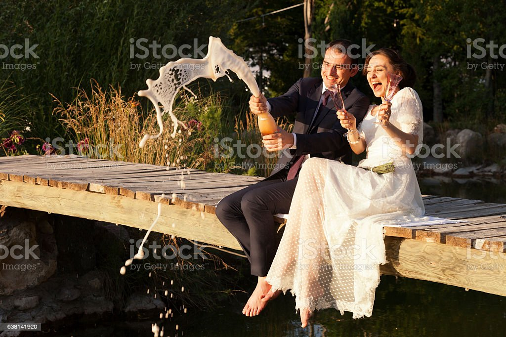 Bride and groom in a garden stock photo
