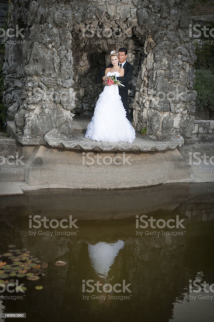 Bride and groom in a park outdoor - Married couple royalty-free stock photo