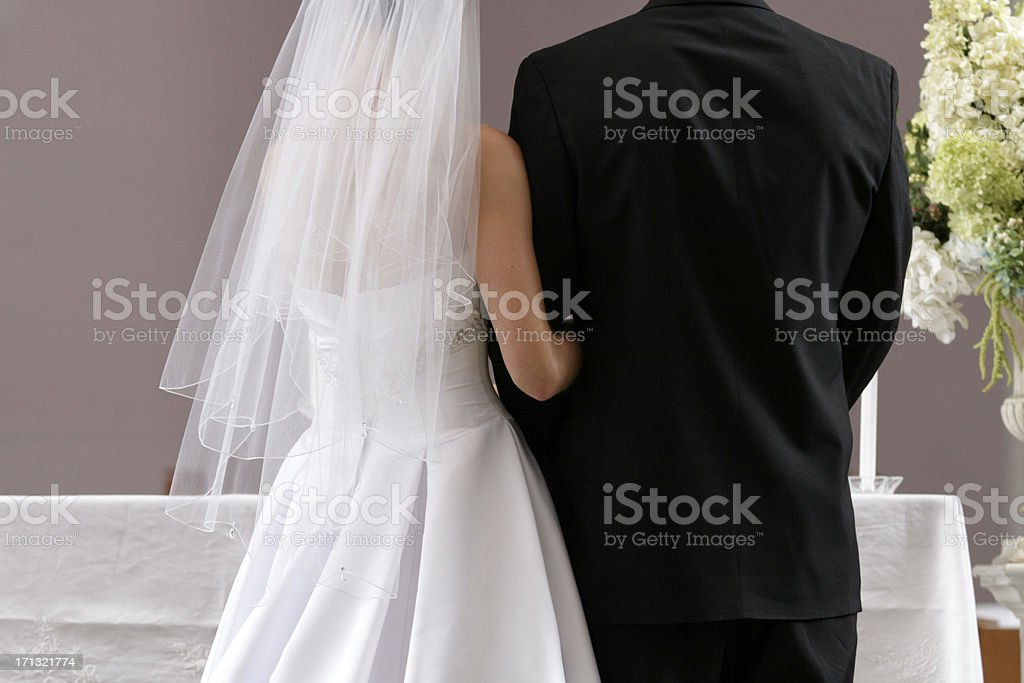 Bride and Groom In Church at Wedding Ceremony Taking Communion stock photo