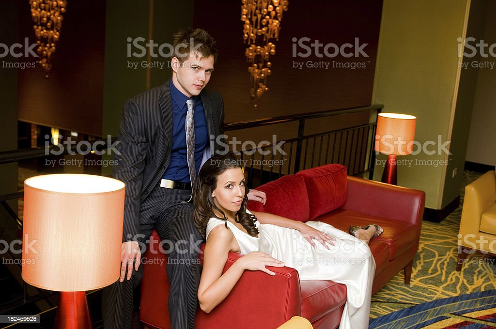 Bride and Groom in modern hotel lobby royalty-free stock photo