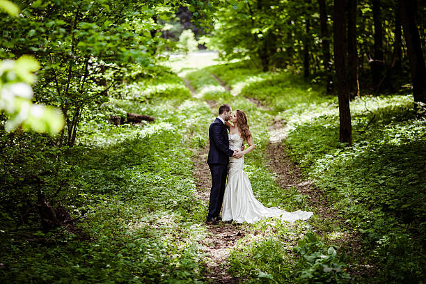 Bride and groom in the spring forest stock photo